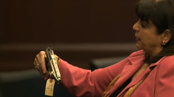 (State Attorney Angela Corey shows Dunn's pistol to jury.)