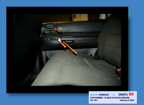 (Trajectory dowels showing entry of bullets to Jordan Davis' seat..)