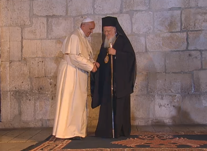 (Pope Francis greeted by Ecumenical Patriarch Bartholomew I at Church of the Holy Sepulchre)