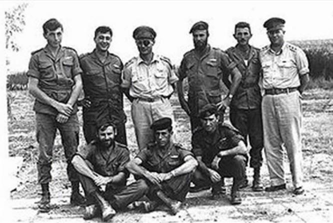 (1953 - Commando Unit 101 - Ariel Sharon Second from Left, Second Row)(source: