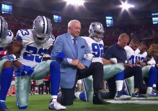 Three Miami Dolphins kneel during national anthem in London